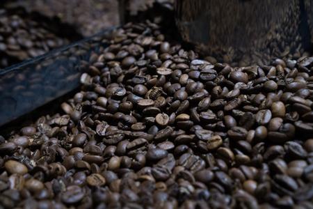 Mixing roasted coffee Stock fotó