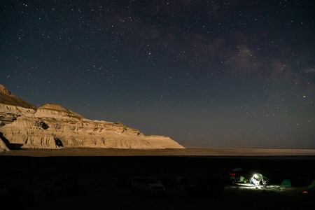 Star at night in the steppe over the mountains