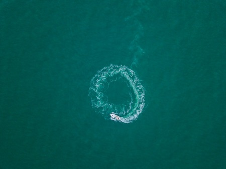 Aerial view of the boat made a circle on the water