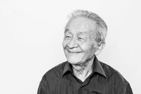 Portrait of Asian elderly senior man. Smiling, Happy old age. Black and white photo. 免版税图像