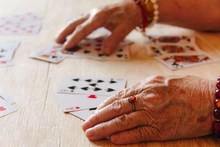 Guessing cards reading, grandma magic, fortune telling, women hands, destiny prediction