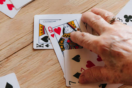 Guessing cards reading, grandma magic, fortune telling, women hands, destiny prediction Imagens