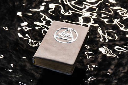 White magic book. Beautiful occult ritual. Power of water. Spititual mood.