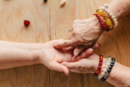 Grandma magic, fortune telling, palmistry. Chiromancy, women hands, destiny reading