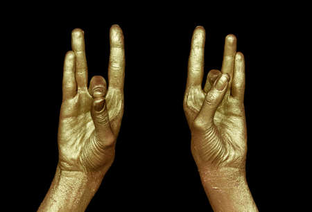 Two golden hands on black background. Indian symbol of crystal Life and meditation and purification.