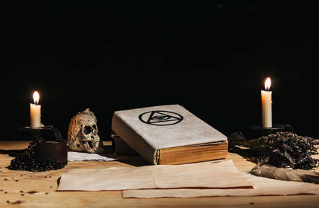 Occult ritual of white magic using grimoire, old book, candles Kho ảnh