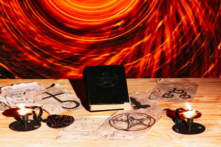 Occult ritual, opening spiritual dimentional portal, black and white magic symbols on altar
