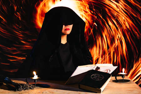 Witch is conducting occult ritual, opening spiritual dimentional portal, black and white magic symbols on altar