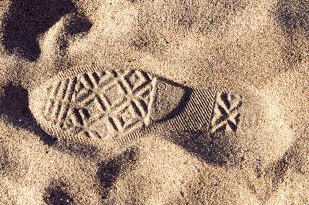 shoeprint: Shoeprint in the sand at beach