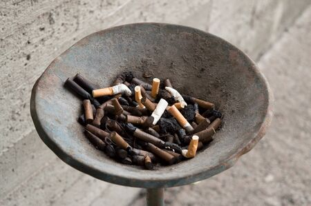 pernicious habit: Picture of ash tray outside Stock Photo