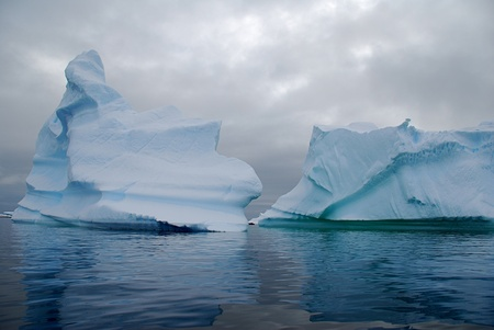 tabular: two blue icebergs floating in freezing ocean Stock Photo