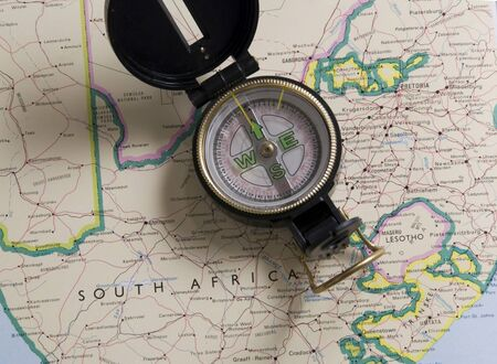 compass lying on a map of south africa photo