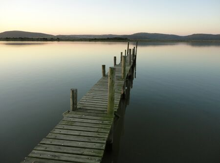 protruding: horizontal shot of a jetty protruding into the water