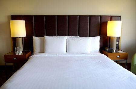 hotel room: crisp white bed in a hotel bedroom