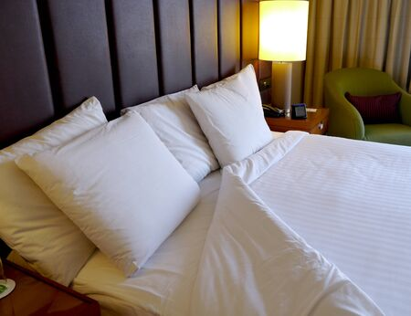 duvet: turned down sheets on a hotel bed