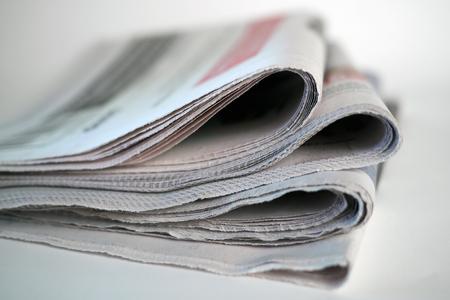 broadsheet: stack of newspapers