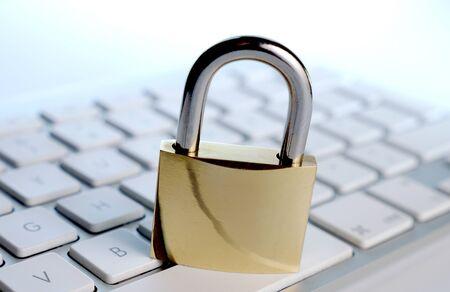 computers online: lock on computer keyboard