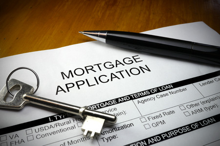 mortgage application: pen and key on mortgage application