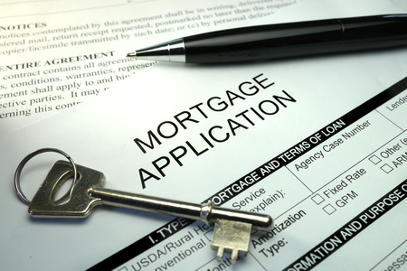 mortgage application: mortgage application document with pen and key