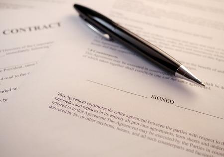 signature: pen on signature line of contract Stock Photo