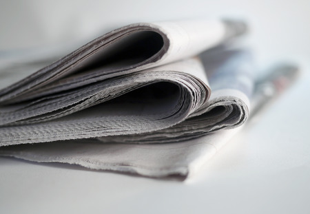 magazine stack: pile of newspapers