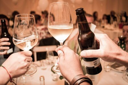 cheers clink of glasses wine beer toast. High quality photo
