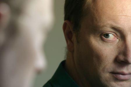 furrow: Man looking at himself in mirror