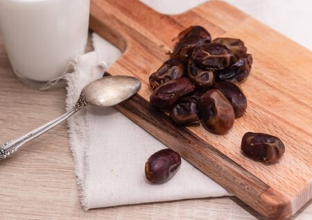 Dried dates, milk on fabric background. concept. Dates wooden board. Vegetarian food. Copy space.