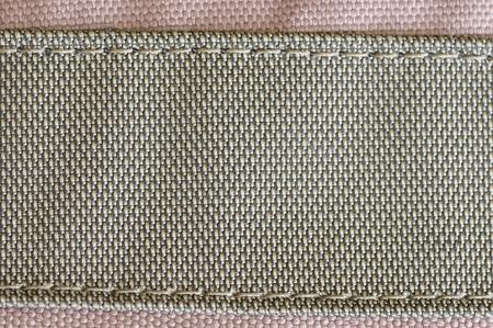 stitched: Stitched fabric.