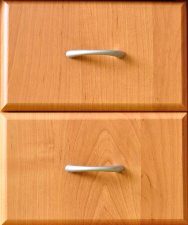 doorhandle: Drawers of the cabinet.