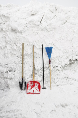 broom handle: Tools for clearing snow. Stock Photo