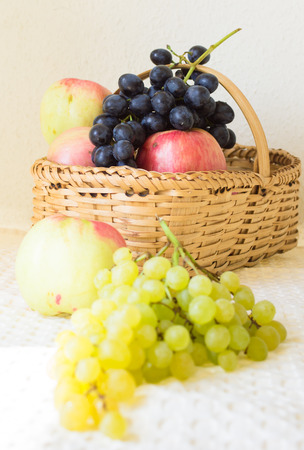 falltime: falltime fruits, apples and grape on the table