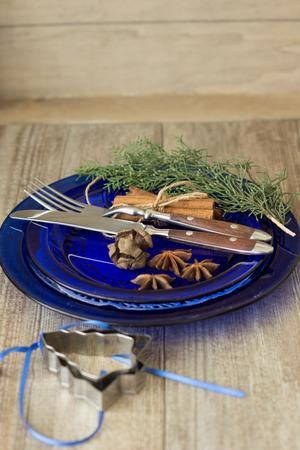 Christmas dinner invitation on wooden background photo