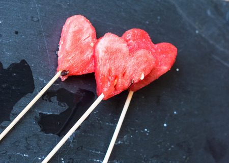 water melon: Water melon cut into heart shape. Stock Photo