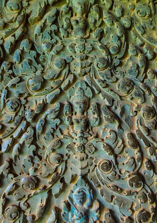 An old ornament on the ancient wall with moss, Angkor Wat, Cambodia