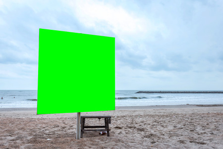 Green screen blank billboard ready for new advertisement at view on sea coast,Tropical beach. Stock Photo