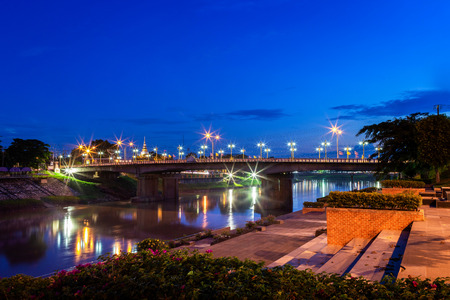 Beautiful light on the Nan River at night on the bridge (Naresuan Bridge) in Phitsanulok City, Thailand