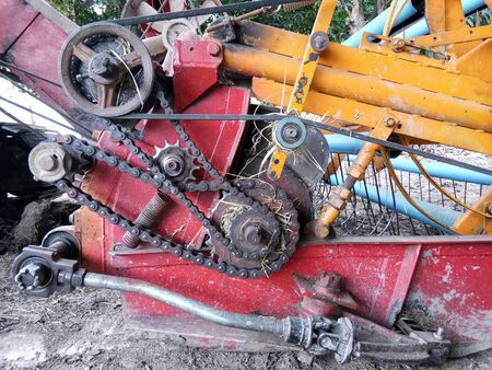 Close-up of detail of the mechanics of an industrial machine combine harvesters, Rotary combine harvester, Agricultural machinery. The machine for harvesting grain crops.