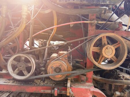 Close-up of detail of the mechanics of an industrial machine combine harvesters, Rotary combine harvester, Agricultural machinery. The machine for harvesting grain crops. Фото со стока