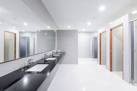 public Interior of bathroom with sink basin faucet lined up Modern design. 写真素材