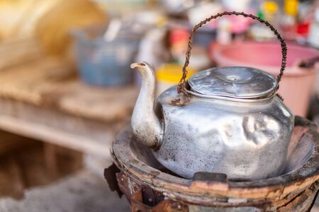 Old Thai kettle on thai charcoal stove on a wooden table are Thai traditional kitchen style.