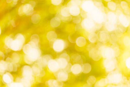 Fondo bokeh amarillo dorado con círculos. Tema abstracto de verano.
