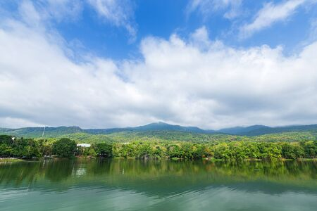 Mountain range forest with the reservoir blue sky background in Ang Kaew Chiang Mai University,Thailand. Banco de Imagens