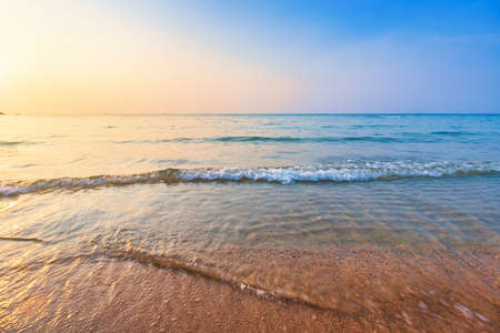 Beautiful early sunset over and Wave of the sea on the sand beach the horizon Summer time at hat sai kaew beach in Chanthaburi Thailand. Reklamní fotografie
