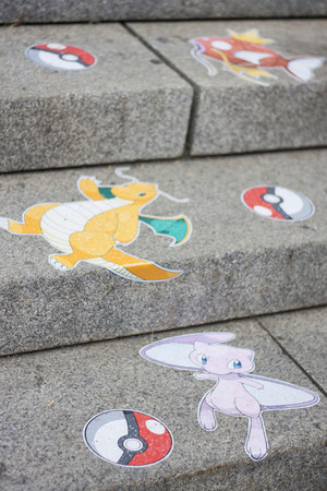 mew: Pokemon Go characters on outdoor city steps Editorial