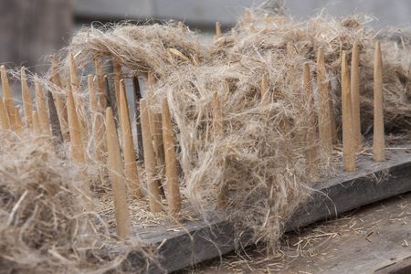An old, traditional tool to process flax fibers Stock Photo
