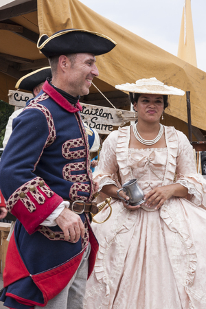 MONTREAL, QUEBEC - AUGUST 28, 2016: A couple dressed in 17th century clothing pose as a soldier and a noblewoman in Montreal Editorial