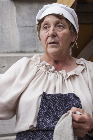 MONTREAL, QUEBEC - AUGUST 28, 2016: An old woman at a historical reenactment event Editorial