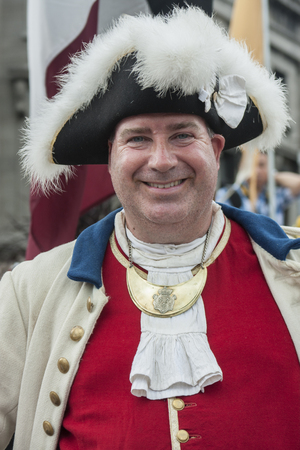 MONTREAL, QUEBEC - AUGUST 28, 2016: A smiling re-enactor dressed in 17th century French clothing Stock fotó - 63685144