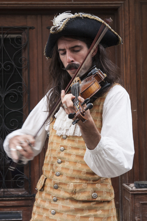 MONTREAL, QUEBEC - AUGUST 28, 2016: A man in 17th century clothing playing a violin Sajtókép